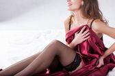 Woman in satin bedding — Foto de Stock