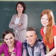 Teacher and students during chemistry lesson — Stock Photo #50522415
