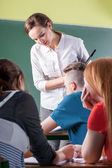 Teacher and students during classes — Stock Photo