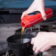 Man changing motor oil — Stock Photo #50584207