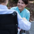 Nurse talking with disabled woman — Stock Photo #50585951