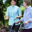 Nurse encourages older woman for walking — Stock Photo #50586329