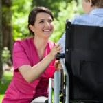 Nurse cares for an elderly woman — Stock Photo