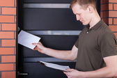 Postman giving letter — Stock Photo