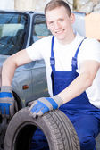 Mechanic chaning near — Stock Photo