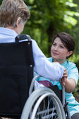 Nurse supports woman with a disability — Stock Photo