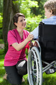 Disabled woman in garden — Stock Photo