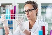 Scientist analyzing test tube — Stock Photo