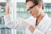 Scientist using pipette — Stock Photo