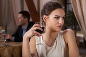 Woman drinking wine — Stock Photo