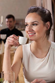 Woman drinking espresso — Stock Photo