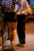 Man giving money to prostitute — Stock Photo