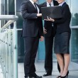 Business team looking at laptop — Stock Photo #50801435