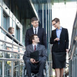 Businessman and his co-workers — Stock Photo #50802963