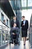 Businessman and his co-workers — Stock Photo