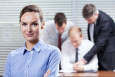 Businesswoman and her co-workers — Stock Photo