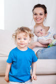 Smiling family in living room — Stock Photo