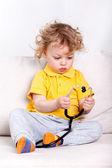Child holding stethoscope — Stock Photo