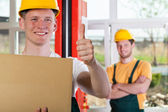 Worker showing thumbs up sign — Stock Photo