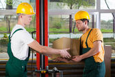 Logistics workers at storehouse — Stock Photo