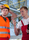 Construction worker and engineer — Stock Photo