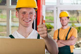 Warehouseman showing thumb up sign — Stock Photo