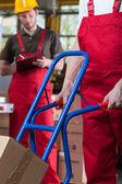 Pushing a manual trolley — Stock Photo