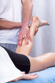 Massage of the calf — Stock Photo