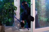 Burglar with crowbar — Stock Photo