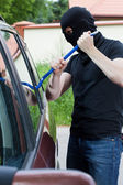 Thief breaking into the car — Stock Photo