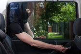 Burglar opening car door — Stock Photo