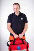Paramedic with first aid kit — Stok fotoğraf