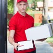 Delivery man requesting a signature — Stock Photo #51163977