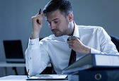 Businessman working overtime — Stock Photo