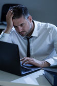 Man during overtime — Stock Photo