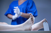 Dead body lying in mortuary — Stock Photo