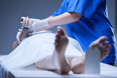 Nurse lying the body of corpse — Stock Photo