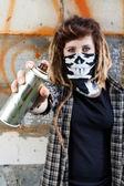 Female hooligan holding graffiti spray — Stock Photo