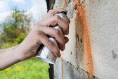 Hand holding graffiti spray — Stock Photo
