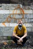 Young rebel on graffiti background — Stock Photo