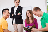 Happy teacher and her students — Stock Photo
