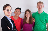 Teacher with her multi-ethnic students — Stock Photo