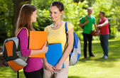 Friends from school talking in park — Stock Photo