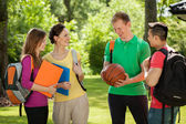 Students talking outdoors — Stock Photo