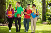 Happy college students outdoors — Stock Photo
