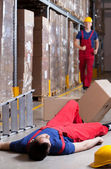 Warehouseman after accident at height — Stock Photo