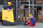 Forklift accident in storehouse — Stock Photo