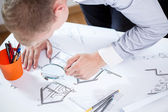 Architect works on big house project — Stock Photo