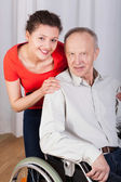 Smiling grandpa and granddaughter — Stock Photo