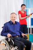 Disabled man and helpful granddaughter — Stock Photo